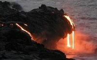 Photo of hot lava flowing into ocean